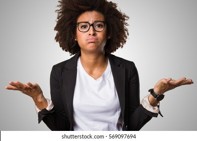 business black woman doubting on a grey background