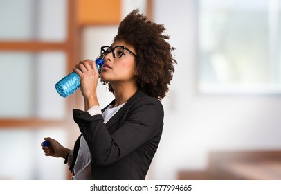 business black woman drinking water