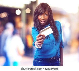 business black woman holding a credit card