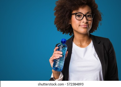 business black woman holding a cup of coffee and files