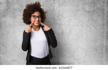 business black woman pointing her mouth