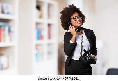 business black woman talking on telephone