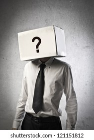 Business body with box, on which is drawn a question mark, instead of the head