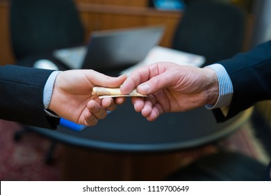 Business bribery concept, man giving money to another one