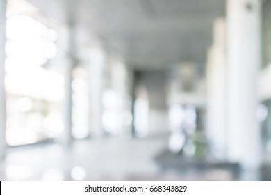 Business building blur background office lobby hall interior empty indoor room with blurry light from glass wall window