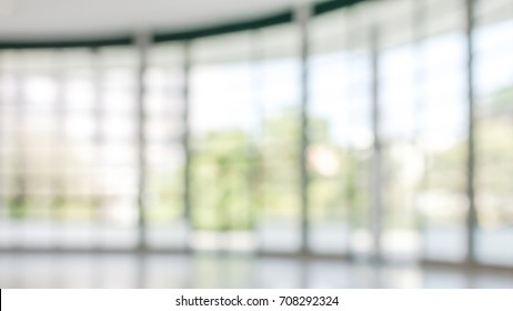 Business building blur background office lobby hall interior of white empty room with blurry light from glass wall window