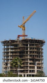 Business Building Contruction Crane is at the top of a new high rise project in St. Petersburg, Florida