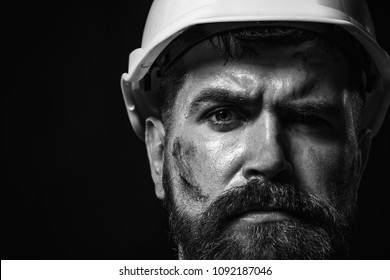 Business, building, industry, technology - builder concept. Hard work. Portrait bearded man with protect helmet wearing. Man builder. Industrial worker. Mechanical worker. Copy space. Black&white.