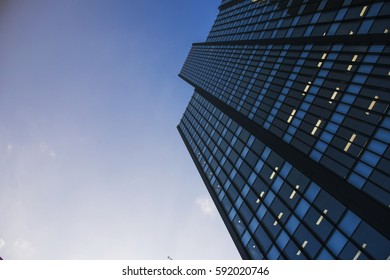 Business building with sky and clouds reflection