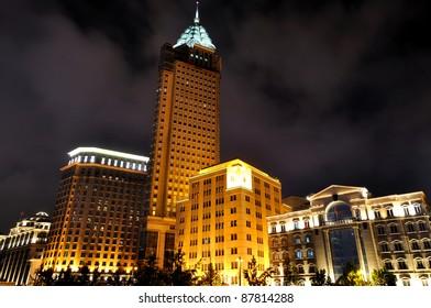 Business buildings in night, Shanghai Bund, China