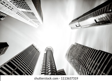 The business buildings of Singapore City. Tall buildings. Shot using wide angle lens with long exposure to blur the clouds.