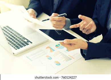 business businessman in meeting analyses chart graphy marketing plan in business project , white tablet screen with  clipping path