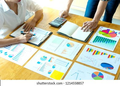 business businessman and woman in meeting analyses chart graphy marketing plan in business project