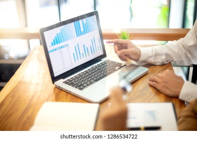 business businessman woman in meeting analyses chart graphy marketing plan in business project