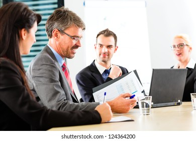 Business - businesspeople have a meeting with presentation in office, they negotiate a contract