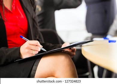 Business - businesspeople have a meeting with presentation in office, they negotiate a contract - closeup