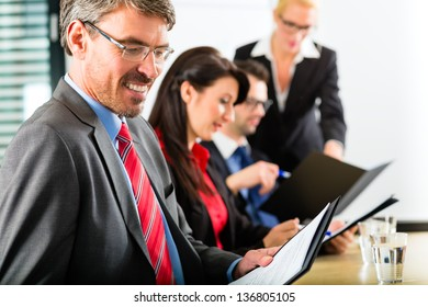 Business - businesspeople have a meeting with presentation in office, they negotiate a contract - Portrait of a businessman