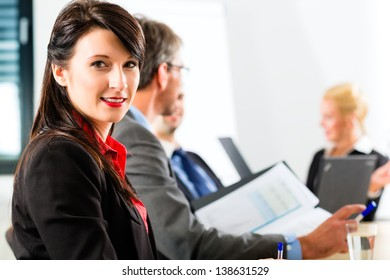 Business - businesspeople have a meeting with presentation in office, they negotiate a contract - Portrait of a businesswoman