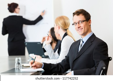 Business - businesspeople have a meeting or workshop with presentation in office