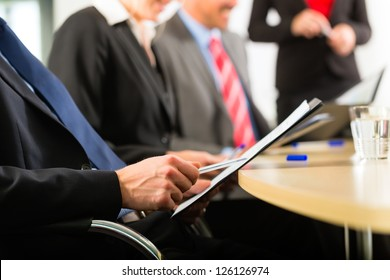 Business - businesspeople have a meeting or workshop with presentation in office, they negotiate or sign a contract