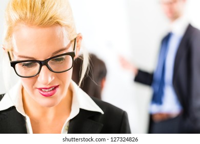 Business - businesspeople have team meeting or workshop in an office - Portrait of a businesswoman
