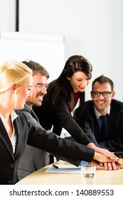 Business - businesspeople have team meeting or workshop in an office and joining hands, it is a very good team