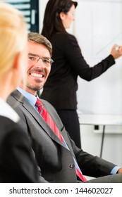 Business - businesspeople have team meeting or workshop in an office, it is a very good team �¢?? Portrait of a businessman