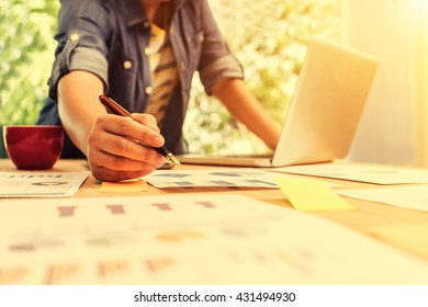 Business, businesswoman analyzing investment charts. Accounting, Business concept, soft focus, vintage tone