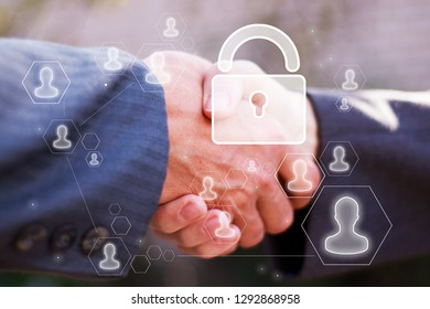 Business button lock security on background business partnership handshake concept. Two coworkers handshaking process of interaction.