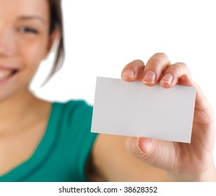 Business card. Beautiful young woman with big smile displaying a blank business card. Shallow depth of field, focus on card. Isolated on white background