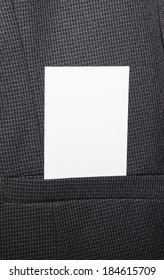 Business card being placed in pocket