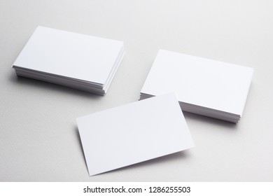 Business card blank on wooden background. Corporate Stationery, Branding Mock-up. Creative designer desk. Flat lay. Copy space for text