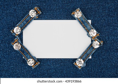 Business card with four straps jeans with rhinestones, lies on the light denim, with space for your text