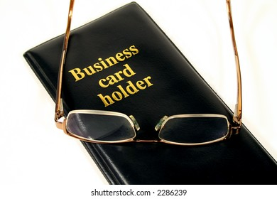 Business card holder with glasses.