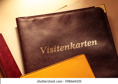 Business card holder with title in German and other notebooks