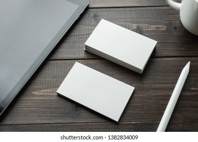 Business card mockup, Blank white business card and tablet with stylus pencil on wood table