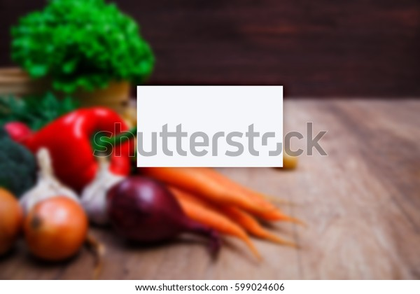 Business card mockup. Vegetables. Potatoes, carrot and red pepper. Lettuce salad, garlic and onion. Natural organic bio food.
