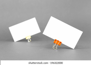 Business card template mockup for branding identity and logo prints with blank modern devices. Isolated on gray paper background.