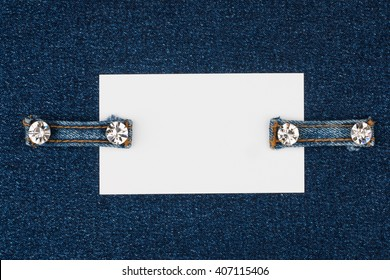 Business card with two straps  jeans, lies on the dark denim, with space for your text