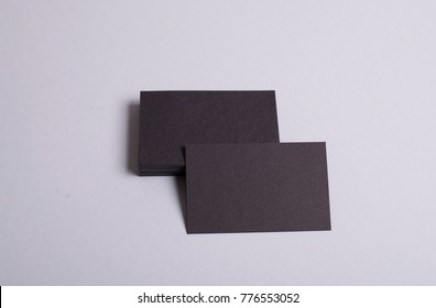 Business cards in black color on lilac background. Mockup.