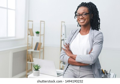 Business Career. Afro Businesswoman Sitting On Office Table At Work. Empty Space