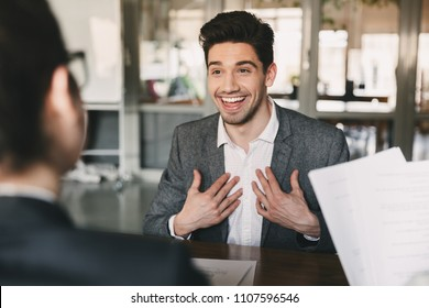 Business, career and placement concept - surprised caucasian man 30s rejoicing and showing at himself when hiring during job interview with employees in office