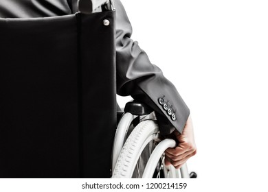 Business career and professional competition success concept - invalid or disabled businessman in black suit sitting wheelchair white isolated