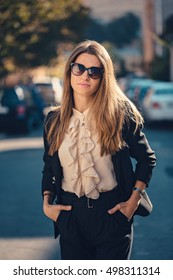 Business casual look, Office wear for women, Formality of business wear. Fashion-savvy girl wearing sunglasses in her way to work, cool business outfit