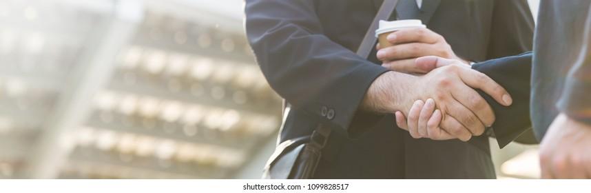 Business caucasian man shaking hands in street city outdoors. Teamwork friendship business entrepreneur partnership  greeting brainstorm winning success synergy communication concept banner