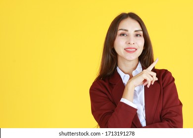 Business Caucasian woman in red suit smiling and thinking for good idea isolated on yellow background.