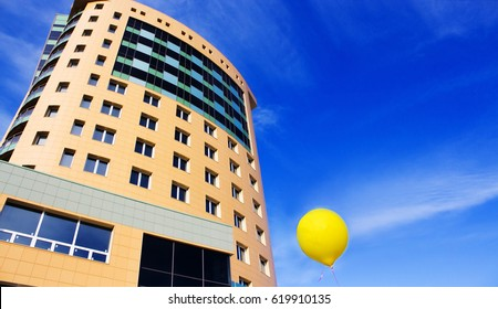 Business center on a background of a yellow air balloon, a symbol of successful business