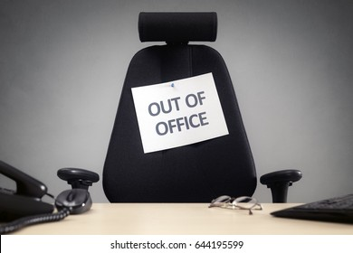 Business chair with out of office sign concept for vacation, holiday, lunch break or work life balance