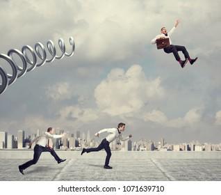 business challenge, businessman take advantage using huge metal spring