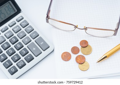 Business chart with calculator, eyeglases, pen and coins